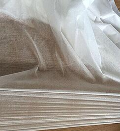 Cost-effective elastic non-woven fabric